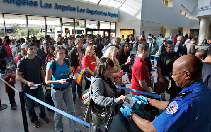 Travelers form a long security check line that is extended out of departure lounge at Los Angeles airport on December 26, 2009, as security has been heightened at the airports after an attempted terrorist attack on a Christmas Day flight landing in Detroi
