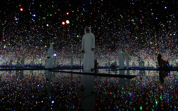 TO GO WITH AFP STORY BY WISSAM KEYROUZVisitors walk inside an art installation by Yayoi Kusama titled  Infinity Mirrored Room - Filled with the Brilliance of Life  at a pre-opening exhibition titled  Seeing Through Light Selection from the Guggenheim Abu