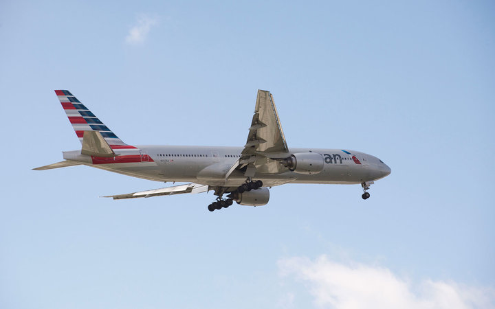 American Boeing 777 with landing gear down in preparation to land. (Photo by: Education Images/UIG via Getty Images)
