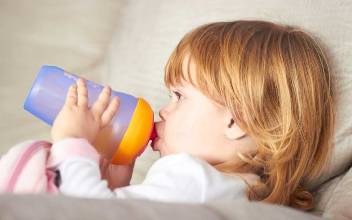 Shot of an adorable little girl drinking from a sippy cuphttp://195.154.178.81/DATA/istock_collage/0/shoots/781088.jpg