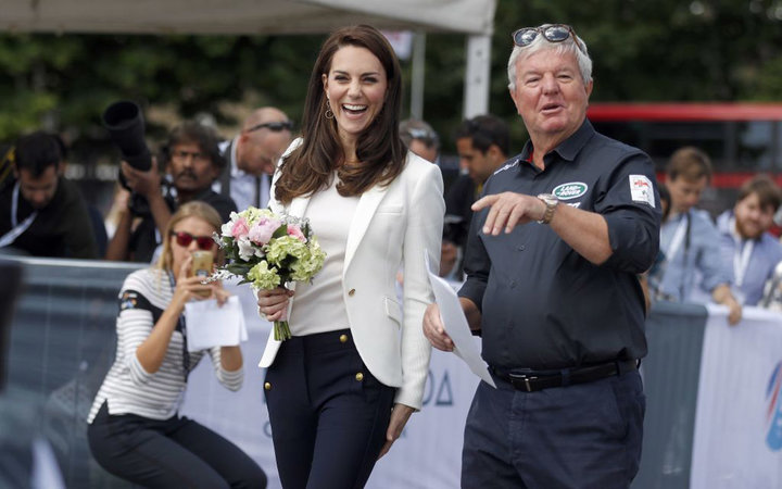 Britain's Catherine, Duchess of Cambridge (C), Patron of the 1851 Trust, is welcomed by Keith Mills as she attends the charity's final Land Rover BAR Roadshow at the Docklands Sailing and Watersports Centre in London, June 16, 2017. The 1851 Trust roadsh
