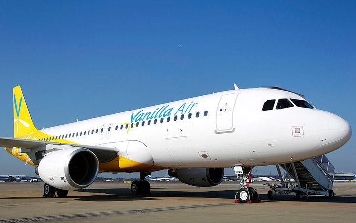 A Vanilla Air Airbus SAS A320 aircraft stands on the tarmac during a media preview at Narita Airport in Narita, Chiba Prefecture, Japan, on Tuesday, Dec. 3, 2013. ANA Holdings Inc. rebranded its low-cost carrier as Vanilla Air after a venture with Sepang,