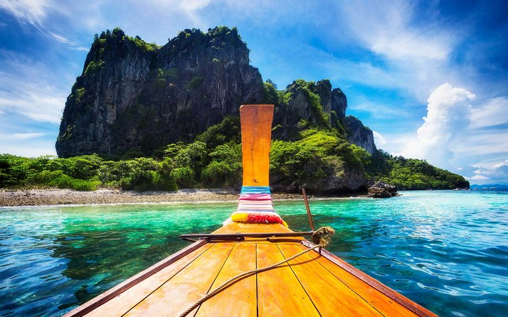 Traditional long tail boat on the way to famous Maya Bay beach in Koh Phi Phi Island, Krabi, Southern Thailan
