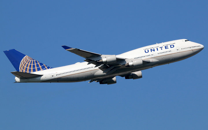 Frankfurt, Germany - September 17, 2014: A United Airlines Boeing 747 Jumbo Jet with the registration N171UA taking off from Frankfurt International Airport (FRA). United Airlines is the world's largest airline with some 693 planes and 138 million passeng
