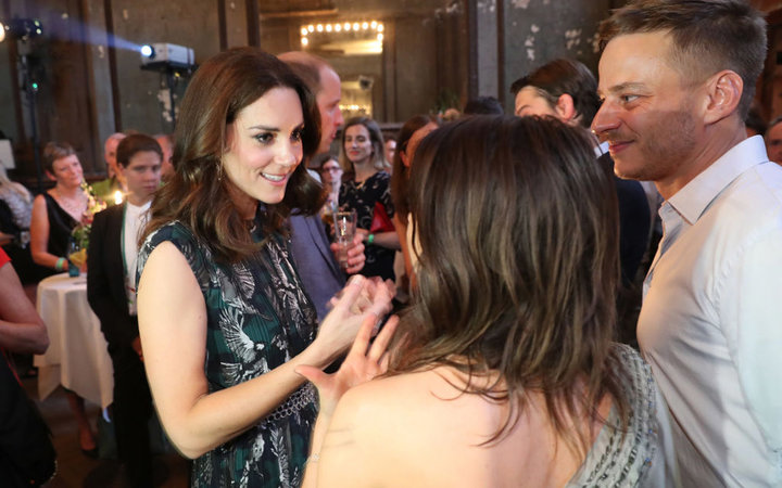 BERLIN, GERMANY - JULY 20:  Catherine, Duchess of Cambridge (L), chats with German actress Jana Pallaske and actor Thomas Wlaschiha at a reception at Claerchen's Ballhaus dance hall following a day in Heidelberg on the second day of the royal visit to Ger