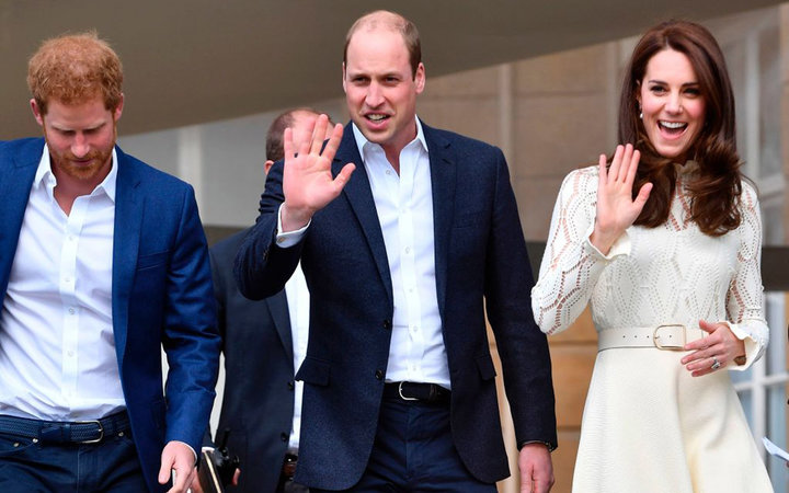 Britain's Prince William, Duke of Cambridge, (C) and Britain's Catherine, Duchess of Cambridge, (R) wave as they host with Britain's Prince Harry (L) a Special Garden Party at Buckingham Palace in central London on May 13, 2017. Their Royal Highnesses ar