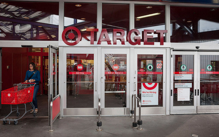 A customer pushes a shopping cart while exiting a Target Corp. store in Seattle, Washington, U.S., on Thursday, May 14, 2015. Target Corp. is scheduled to release earnings figures on May 20. Photographer: David Ryder/Bloomberg via Getty Images