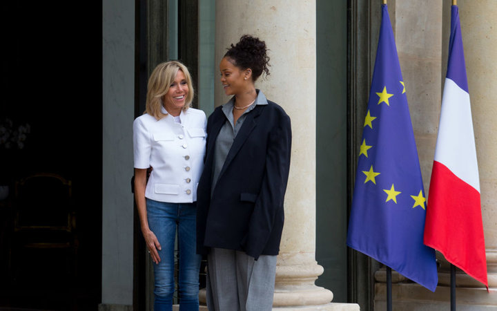PARIS, FRANCE - JULY 26: Brigitte Trogneux (L), Emmanuel Macron's wife, welcomes Rihanna (R), Singer and Founder of Clara Lionel Foundation, who arrives to meet French President (not pictured) at the Elysee Palace on July 26, 2017 in Paris, France. On Ju