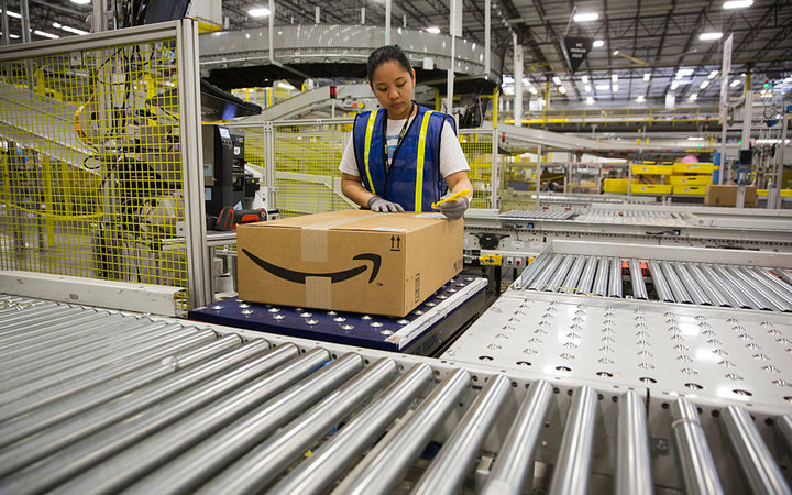 """1.25 million square foot Amazon shipping center in Schertz, Texas. The fulfillment facility includes a proprietary """"robo-stow"""" robotic arm system and employs nearly 500 full-time employees who use the advance tracking system to package orders and place in"""