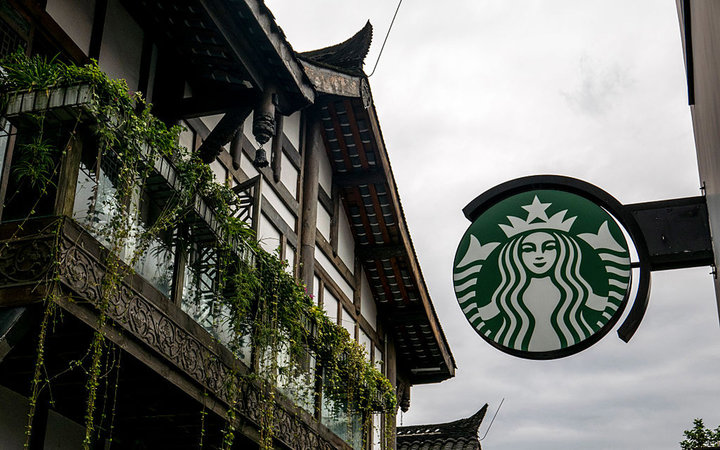 CHENGDU, SICHUAN PROVINCE, CHINA - 2015/09/11: Logo of a Starbucks cafe in Kuan Zhai Alley,  one of the top attractions in Chengdu.  China is Starbucks's fastest-growing market, expected to top 3,400 stores by 2019. (Photo by Zhang Peng/LightRocket via Ge