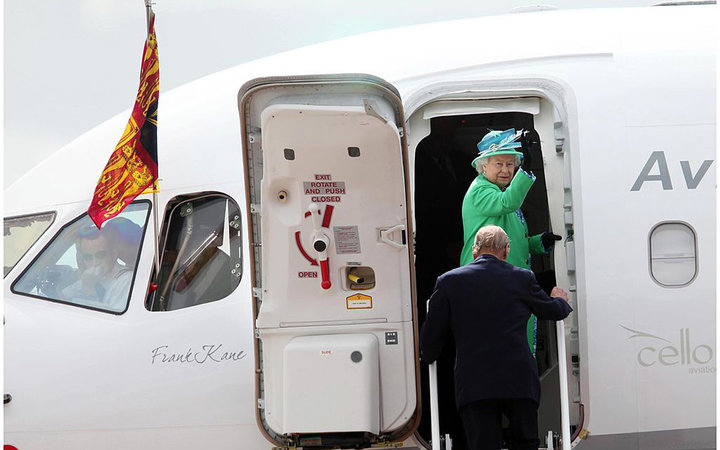 CORK, IRELAND - MAY 20:  Queen Elizabeth II waves as she and Prince Philip, Duke of Edinburgh board a plane to depart Cork Airport on May 20, 2011 in Cork, Ireland. Queen Elizabeth II and Prince Philip, Duke of Edinburgh are on the final day of their hist