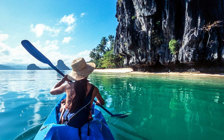 The Philippines, Palawan, El Nido, sea kayaking in Bacuit Bay female adventure Long Term Travel Packing