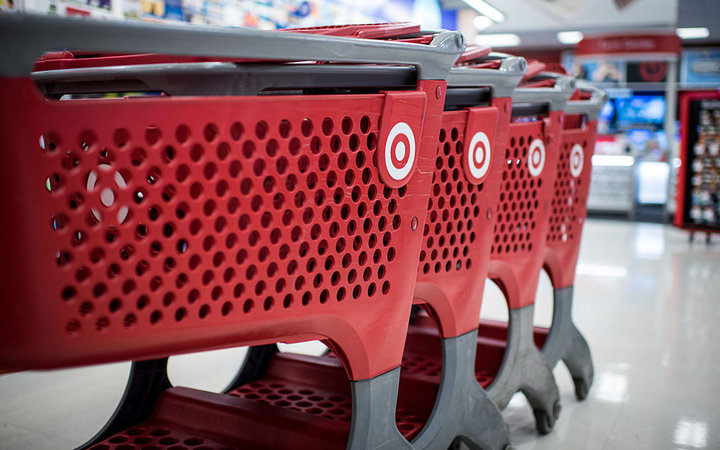 Target Corp. shopping carts sit inside a company store in Chicago, Illinois, U.S., on Monday, May 16, 2016. Target is scheduled to release earnings figured on May 18. Photographer: Christopher Dilts/Bloomberg via Getty Images