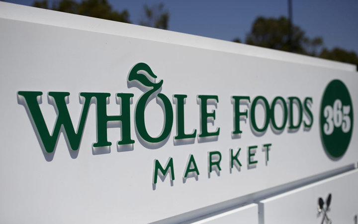 Signage is displayed outside of a Whole Foods Market 365 location during the grand opening in Santa Monica, California, U.S., on Wednesday, Aug. 9, 2017. The fifth Whole Foods Market 365 opened on Wednesday, the second location for the Los Angeles area. P