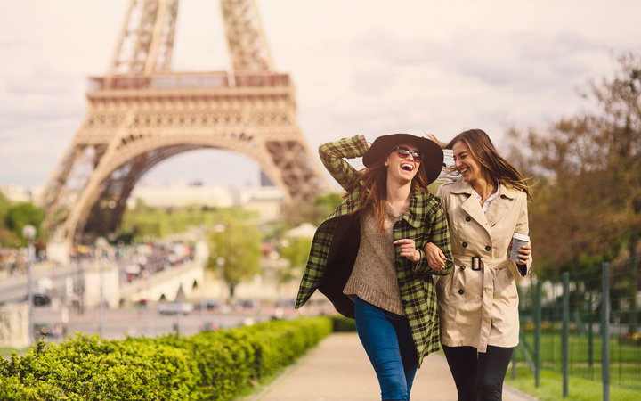 Girls laughing near the Eiffel Tower