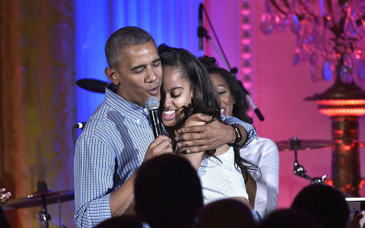 Malia and Barack Obama hug