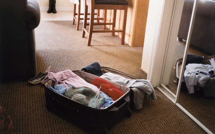 Open Suitcase in Hotel Room