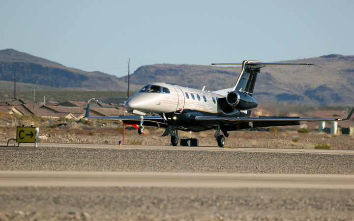 Phenom 300E on a desert runway