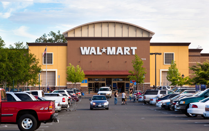 Citrus Heights, California, USA - May 20, 2011: View at a California Walmart storefront from its parking lot. Walmart is an American public multinational corporation that runs chains of large discount department stores and warehouse stores.