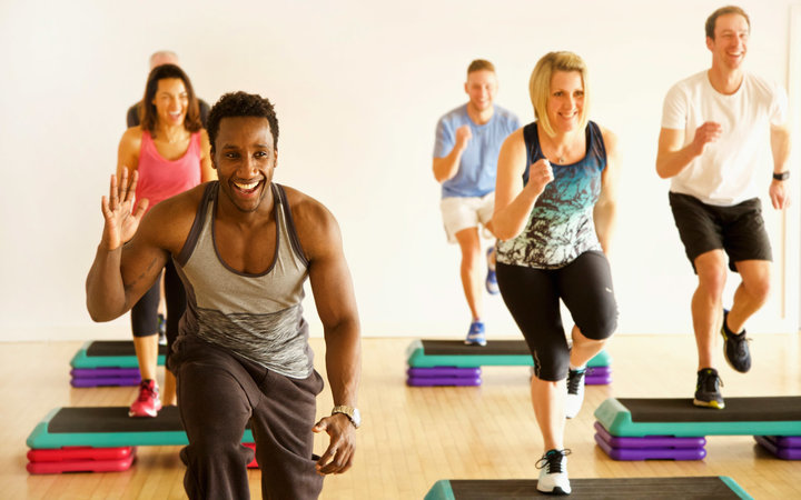 Group of People at Step Aerobics Class