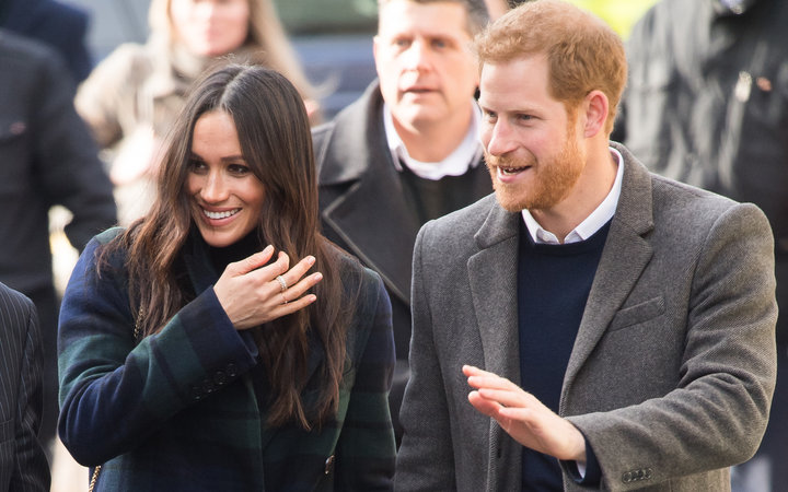 Meghan Markle and Prince Harry greet members of the public