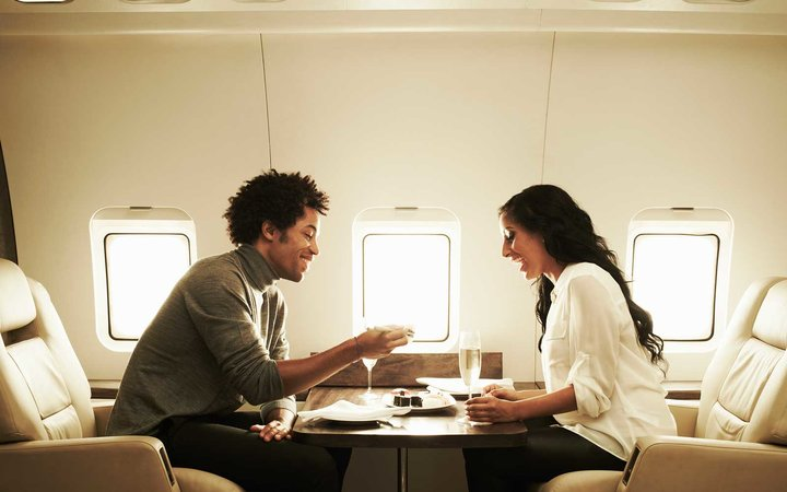 Couple enjoying lunch on private jet