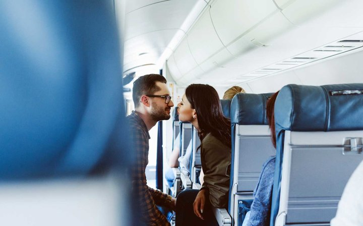 Airplane Passengers Kiss on flight