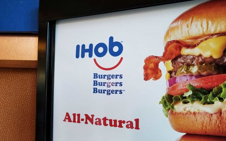 Close-up of sign with IHoB (International House of Burgers) logo, following pancake restaurant International House of Pancake's (IHoP) decision to change its name to IHoB