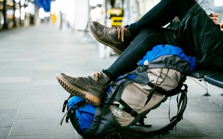 Close up shot of legs and rucksack of a young backpacker