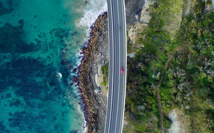 Aerial view of a car driving on a bridge, New South Wales, Australia