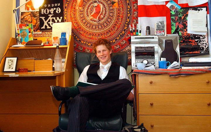 Prince Harry sits in his bedroom at Eton College.