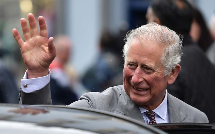 Prince Charles, Prince of Wales waves at Memorial Garden and Strule Arts Centre