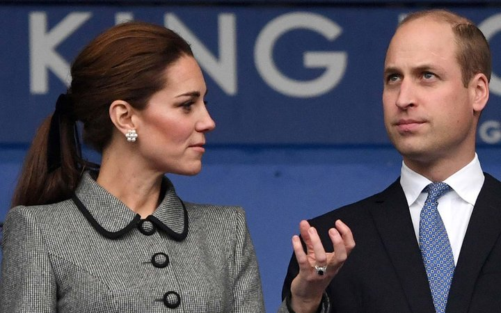Britain's Prince William, Duke of Cambridge, and Britain's Catherine, Duchess of Cambridge react during their visit to the King Power Stadium in Leicester