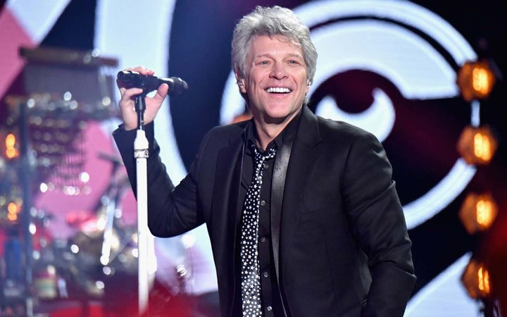 Honoree Jon Bon Jovi of Bon Jovi performs onstage during the 2018 iHeartRadio Music Awards