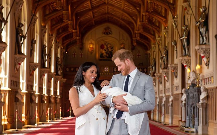 Britain's Prince Harry, Duke of Sussex and his wife Meghan, Duchess of Sussex, pose for a photo with their newborn baby son, Archie Harrison Mountbatten-Windsor