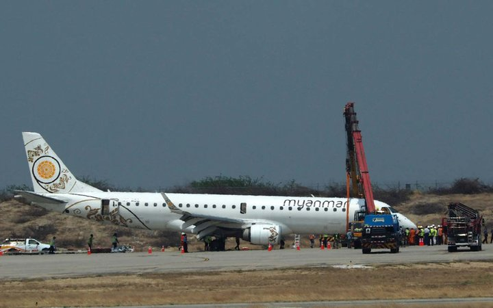 A general view shows a Myanmar National Airlines passenger plane after an emergency landing at Mandalay international airport