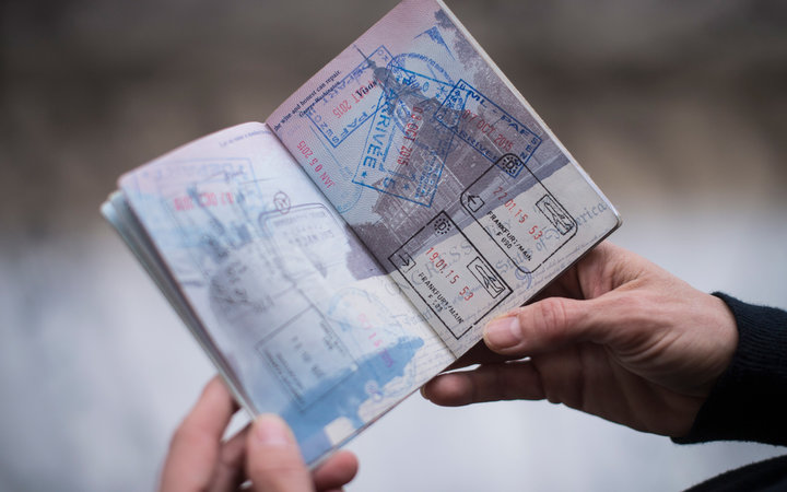 Jennifer Cookoe, head of Africa for the Center for Advanced International Studies, shows off her passport