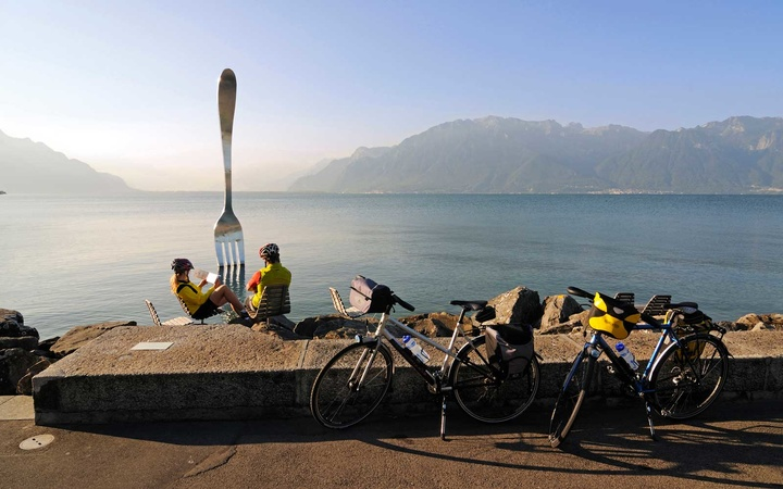 Biker at sculpture of Jean-Pierre Zaugg, La Fourchette, Vevey, Lake Geneva, Switzerland