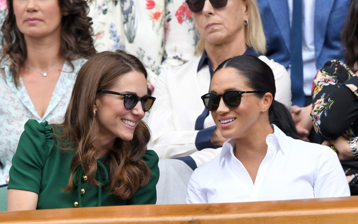Catherine, Duchess of Cambridge and Meghan, Duchess of Sussex in the Royal Box on Centre Court