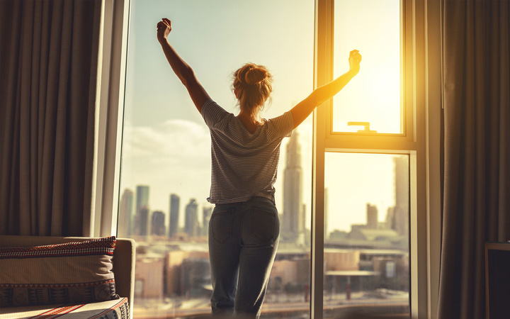 Woman stretches in morning
