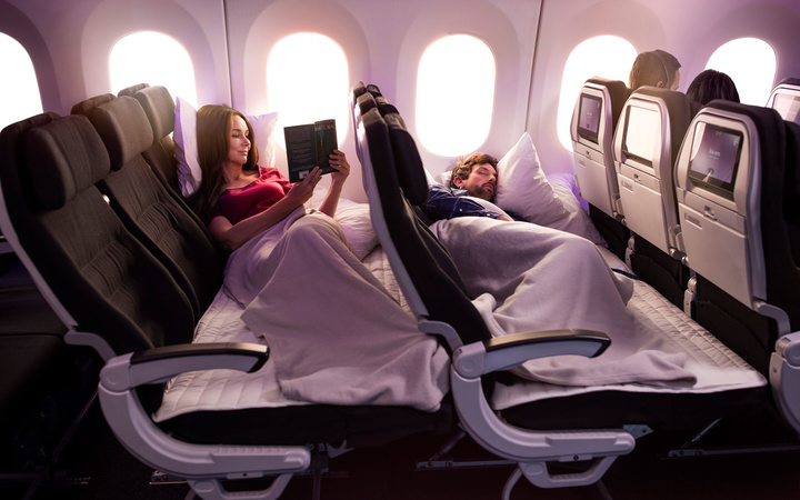 Enjoy an ample amount of space to lie down with Air New Zealand's skycouch.