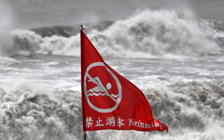A flag warning about rough seas is pictured next to a beach in Suao, Yilan county, as Typhoon Lekima approaches off the shores of eastern Taiwan on August 8, 2019.