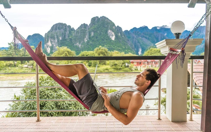 Man relaxing in hammock on vacation