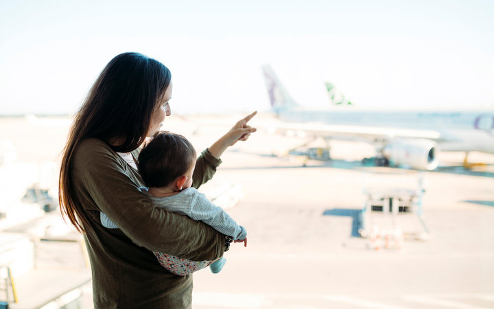 Mom with baby at airport