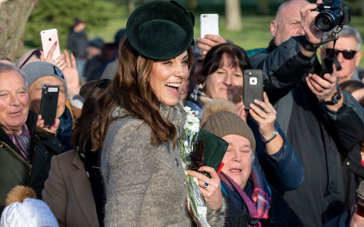 Kate Middleton smiling in front of crowd