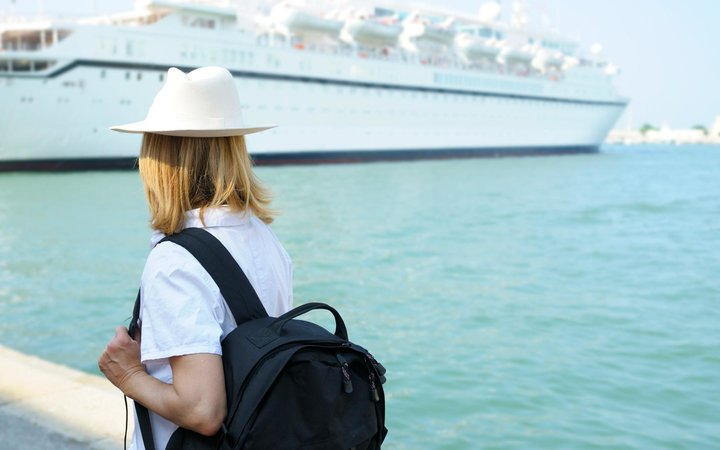 Solo female traveler boarding a cruise
