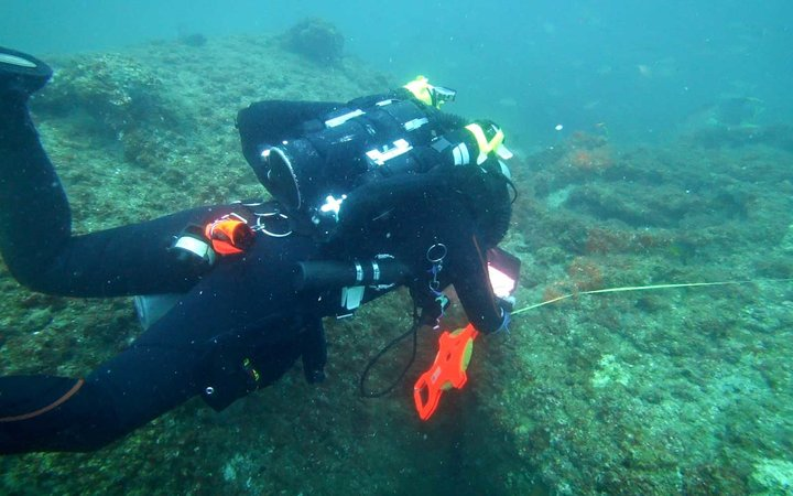 Michael C Barnette measuring the wreck of the SS Cotopaxi