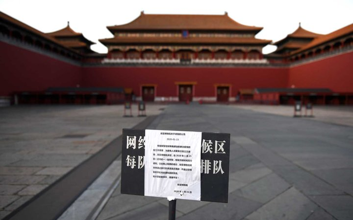 A sign announces the closure of the Forbidden City as part of efforts to prevent the spread of the new coronavirus, in Beijing on February 4, 2020.