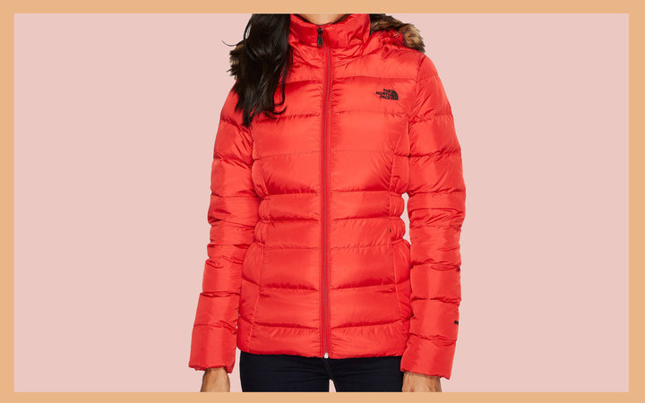 Woman Wearing Red Medium Length Puffer Coat