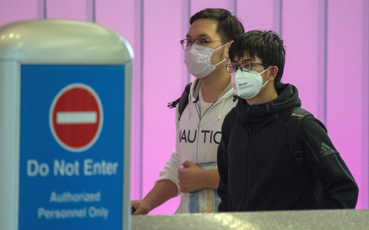 Passengers in facemasks at LAX.